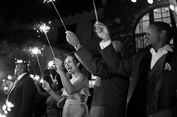 wedding guests hold sparklers