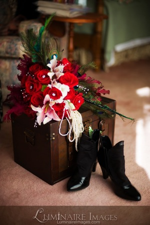 red rose bouquet with peals and black boots