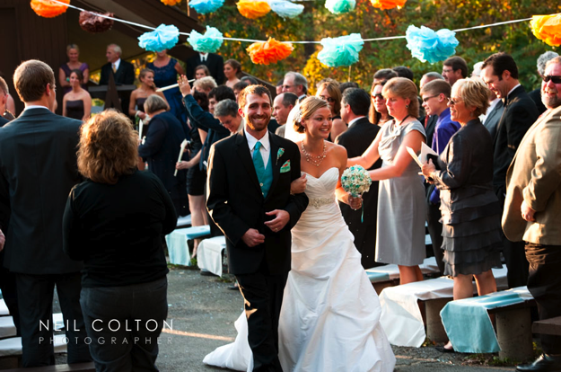 teal and orange accents at outdoor wedding