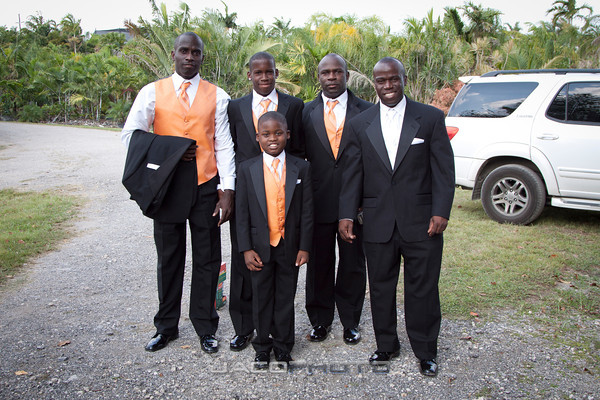 traditionally dressed groom and groomsmen