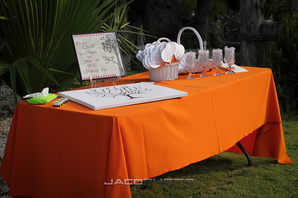 orange guest book table at wedding