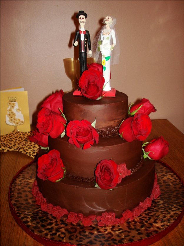 skeletons on wedding cake with red roses