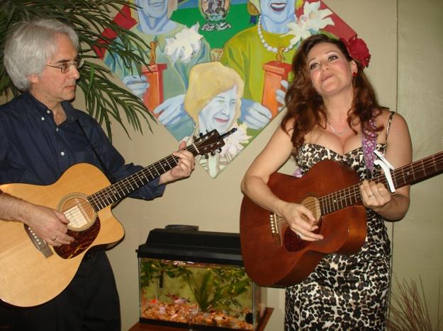 bride with guitar sings to groom