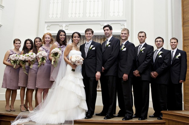 large bridal party with purple bridesmaids dresses