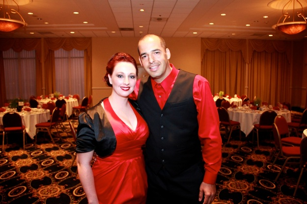 couple in red and black outfits