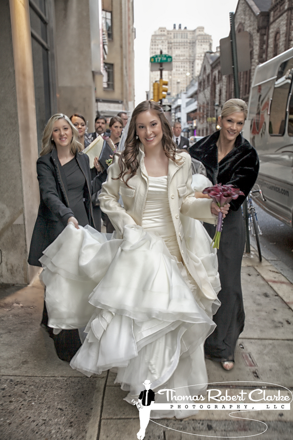 bride in full wedding dress on city street
