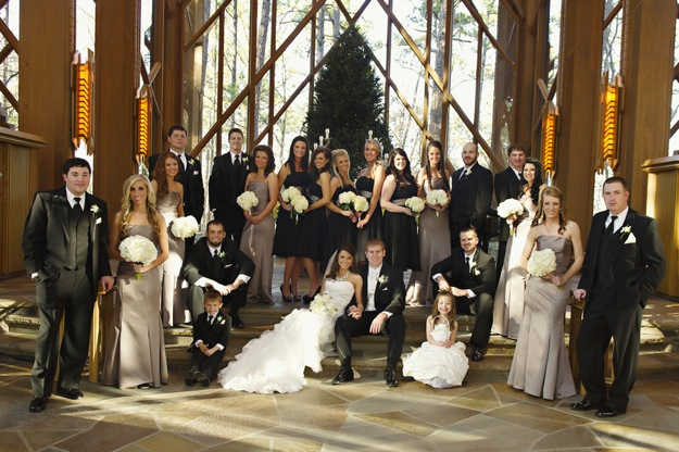 large wedding party wearing tan and black