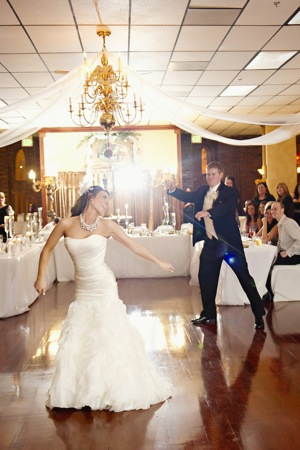 energetic bride and groom dance