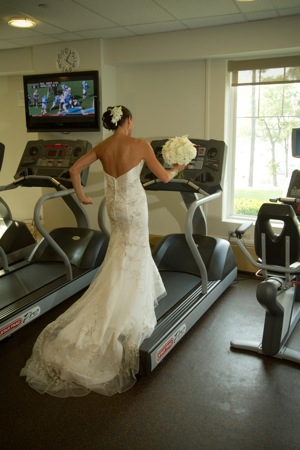 bride in wedding dress on treadmill