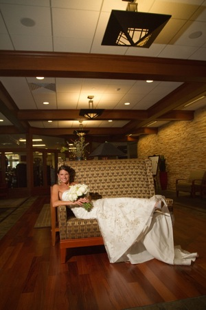 bride on couch in wedding dress