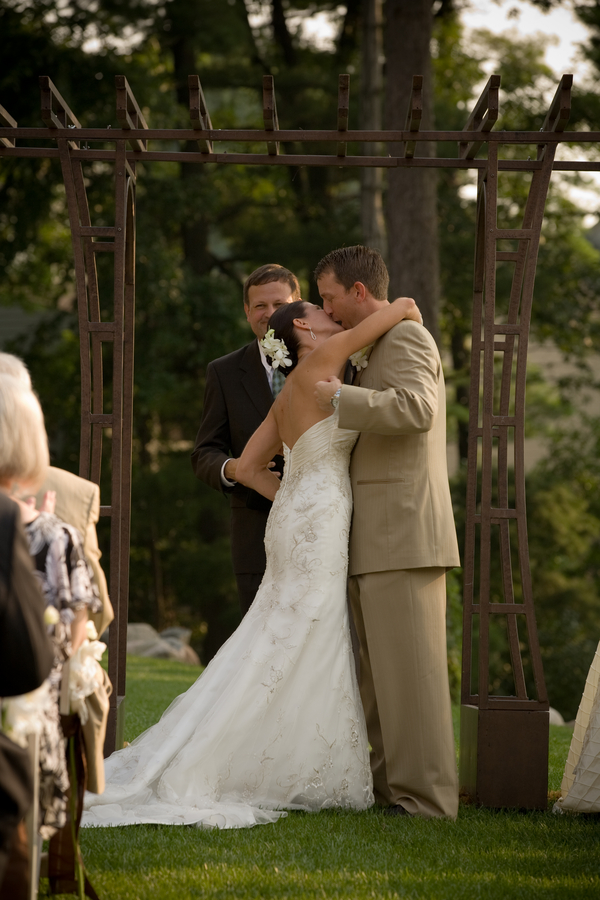 outdoor wedding bride and groom kiss