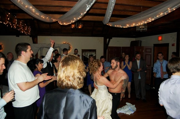 groom without shirt dances with bride