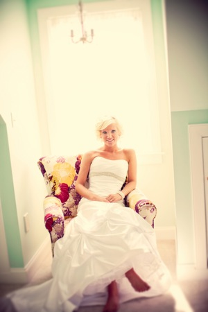 bride in chair with flowers