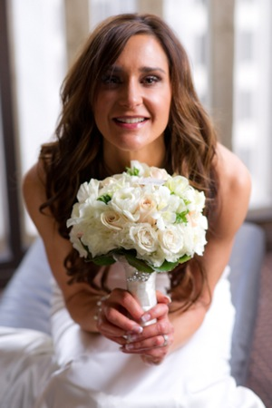 brunette bride with white bouquet