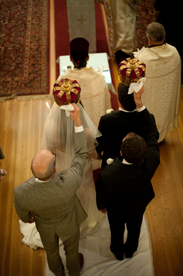 bride and groom with crowns during orthodox ceremony