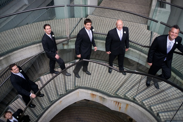 groom and groomsmen on stairs