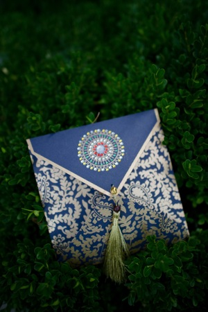 decorated blue and white wedding invitation
