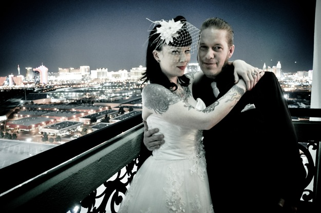 bride and groom on city balcony