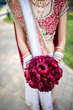 full red flower bouquet with bridesmaid