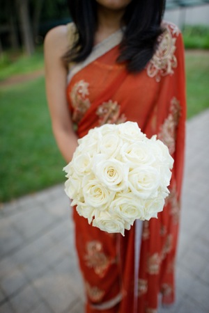 orange sari and white flower bouquet