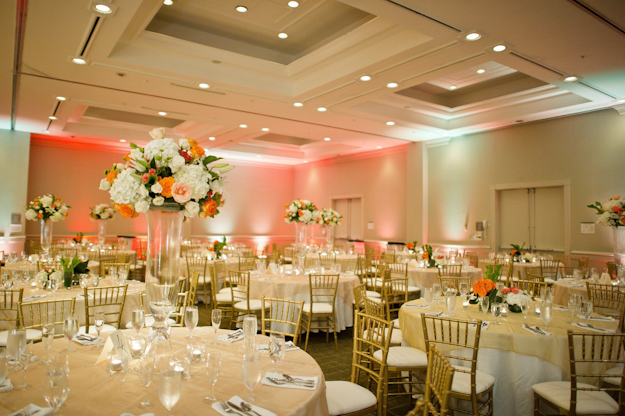 white and orange wedding reception tables