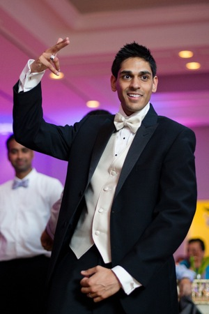 Indian groom in white tie tux dancing