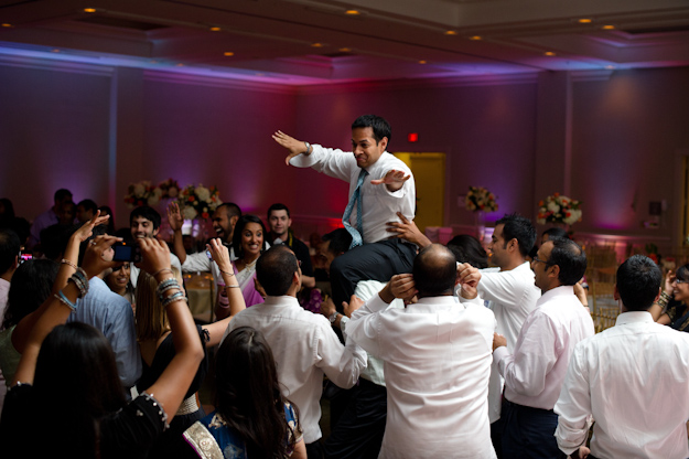 Indian groom on chair dancing