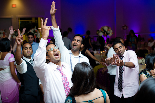 Indian men dance at wedding