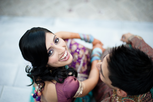 Indian bride looks up at camera