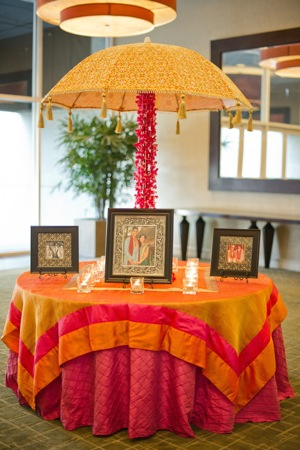 wedding table shrine with pictures of loved ones