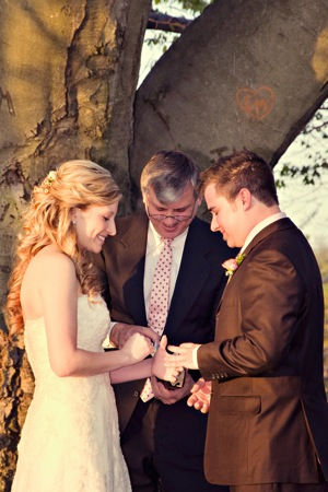 bride and groom get married under tree