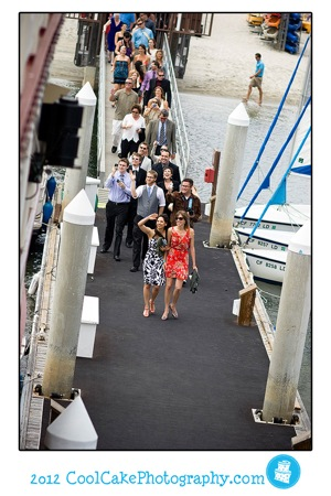 wedding guests walking on to boat