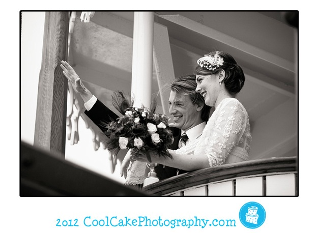 bride and groom on boat wave at guests