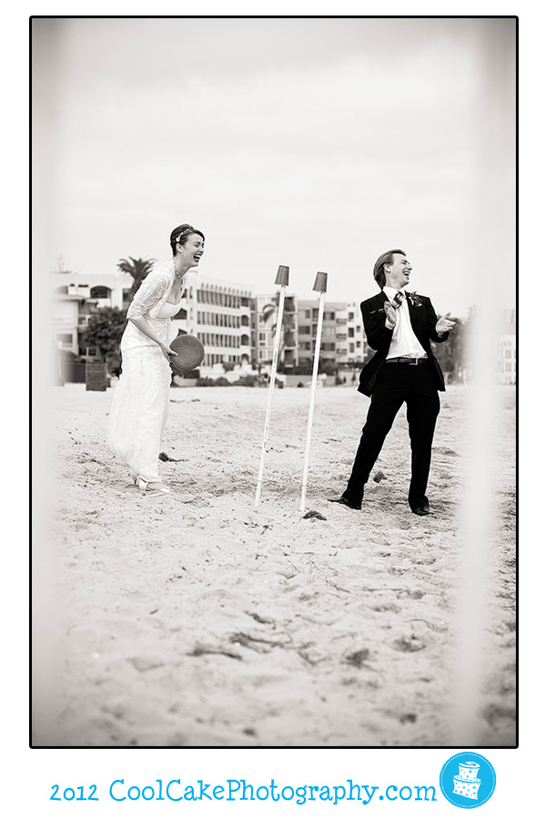 bride and groom play on beach