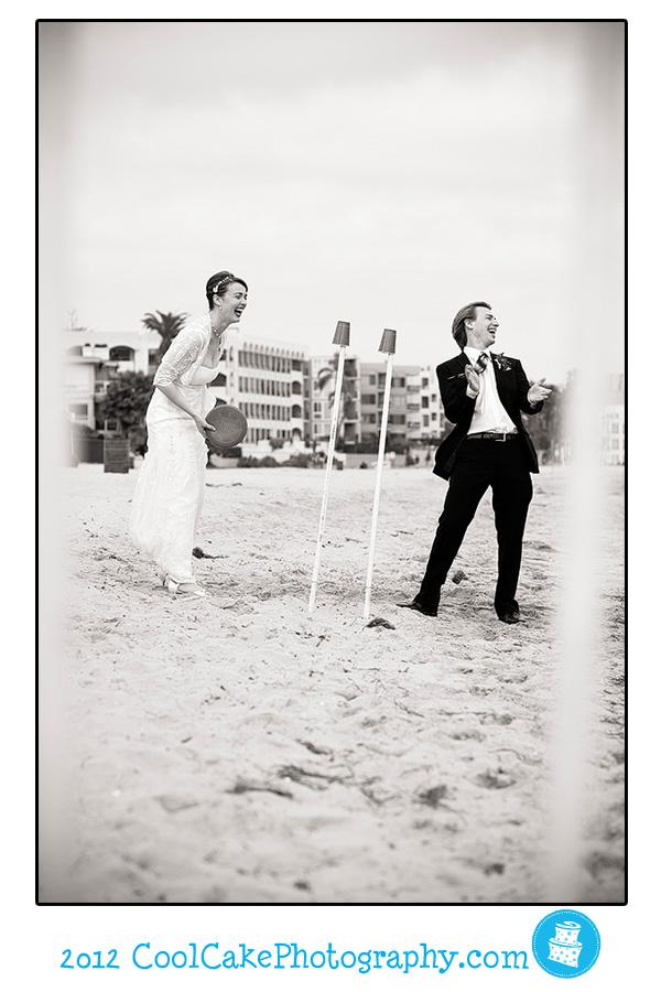 bride and groom play on beach
