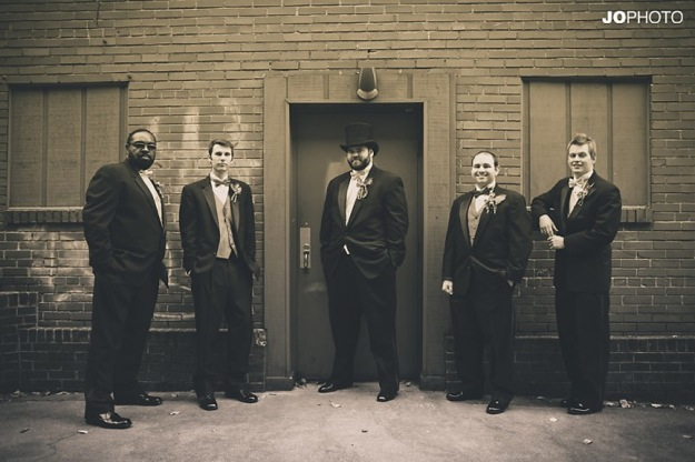 groom and groomsmen in sepia toned photo