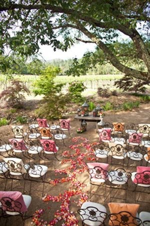 Garden wedding with rose petals strewn