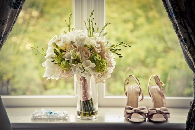 bridal shoes with bouquet and garter