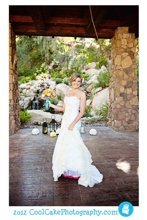 colorful flora bouquet and white wedding dress