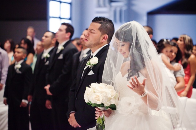 bride prays during wedding ceremony