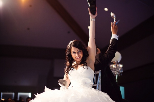 bride and groom with shoes
