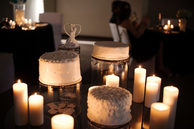 wedding cakes surrounded by candles