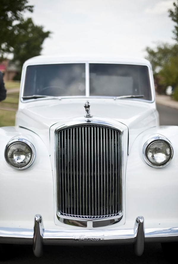 white rolls as wedding day transportation