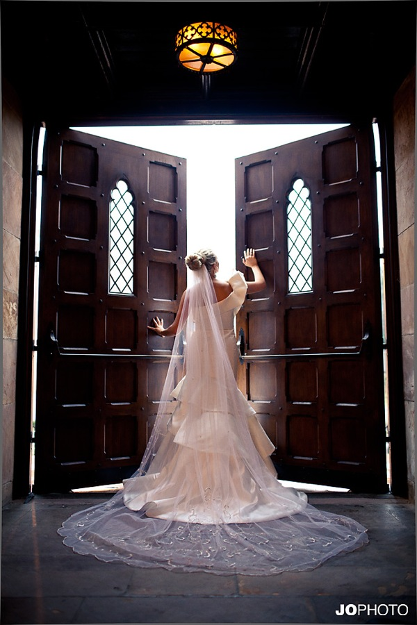 bride in front of door in full veil