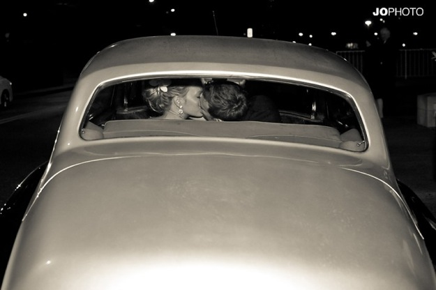 retro car with bride and groom