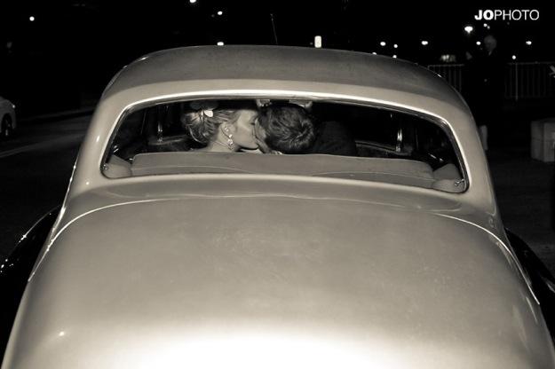 retro car with bride and groom