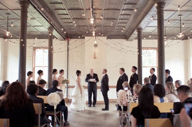 wedding ceremony in open space with tin ceiling