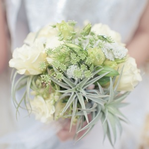 bridesmaid bouquet with green and white succulents