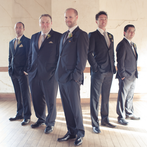 groom and groomsmen in casual suits