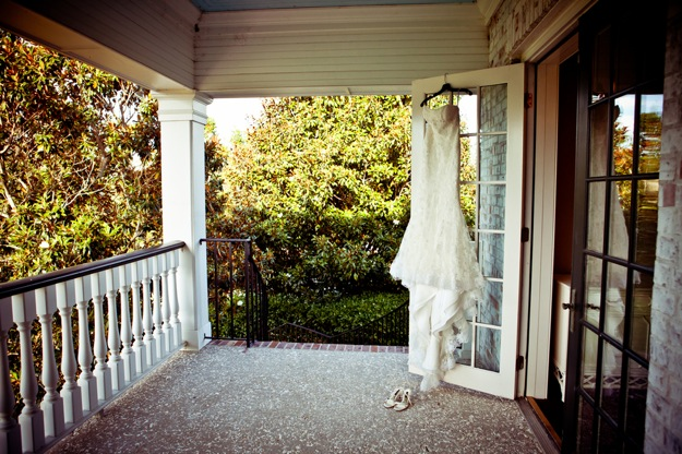 wedding dress in doorway with tree in background
